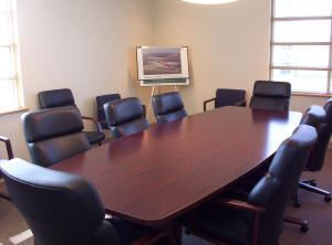 Airport conference room with table and chairs