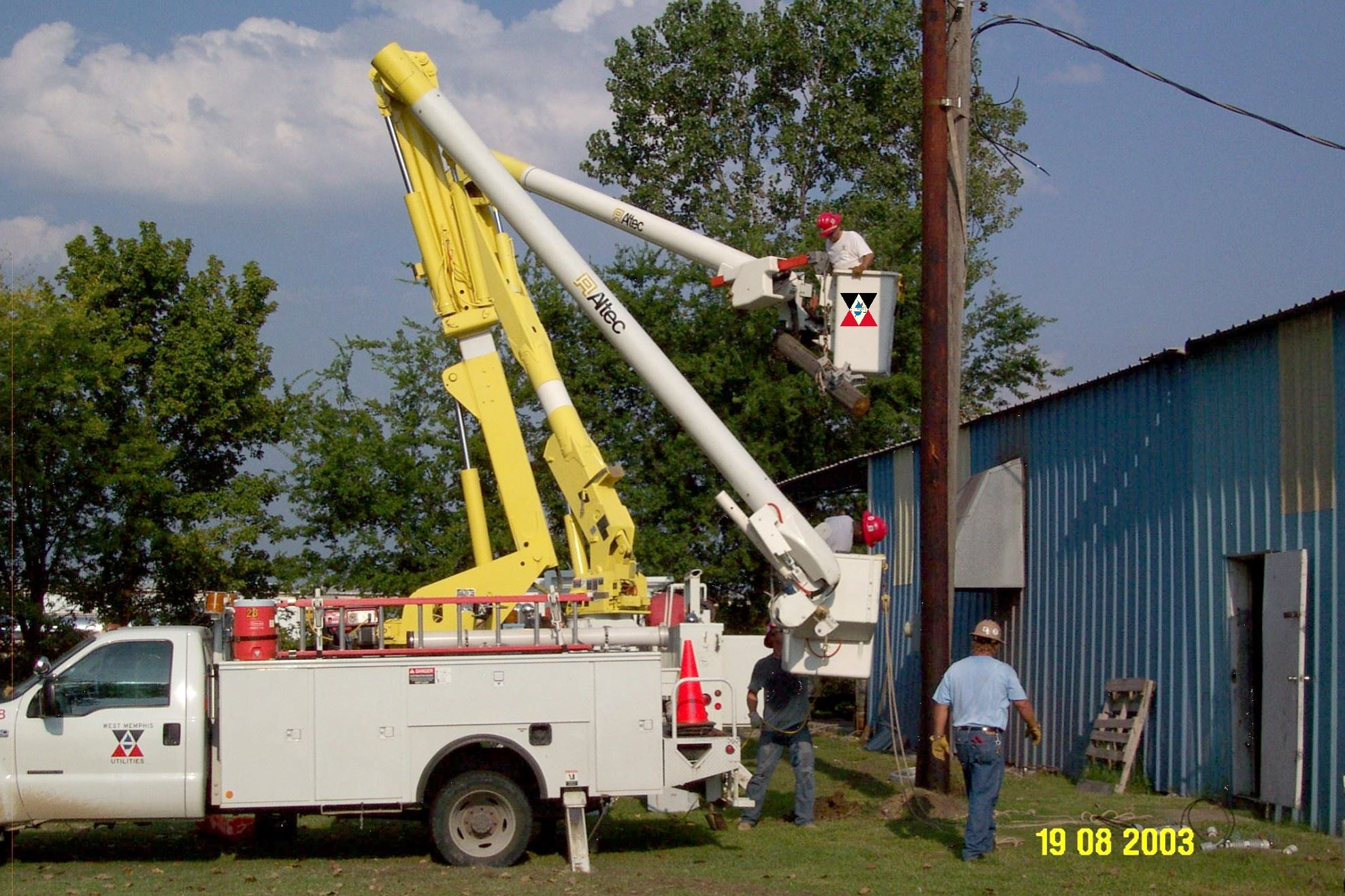 Utility Crew Working on a Power Line