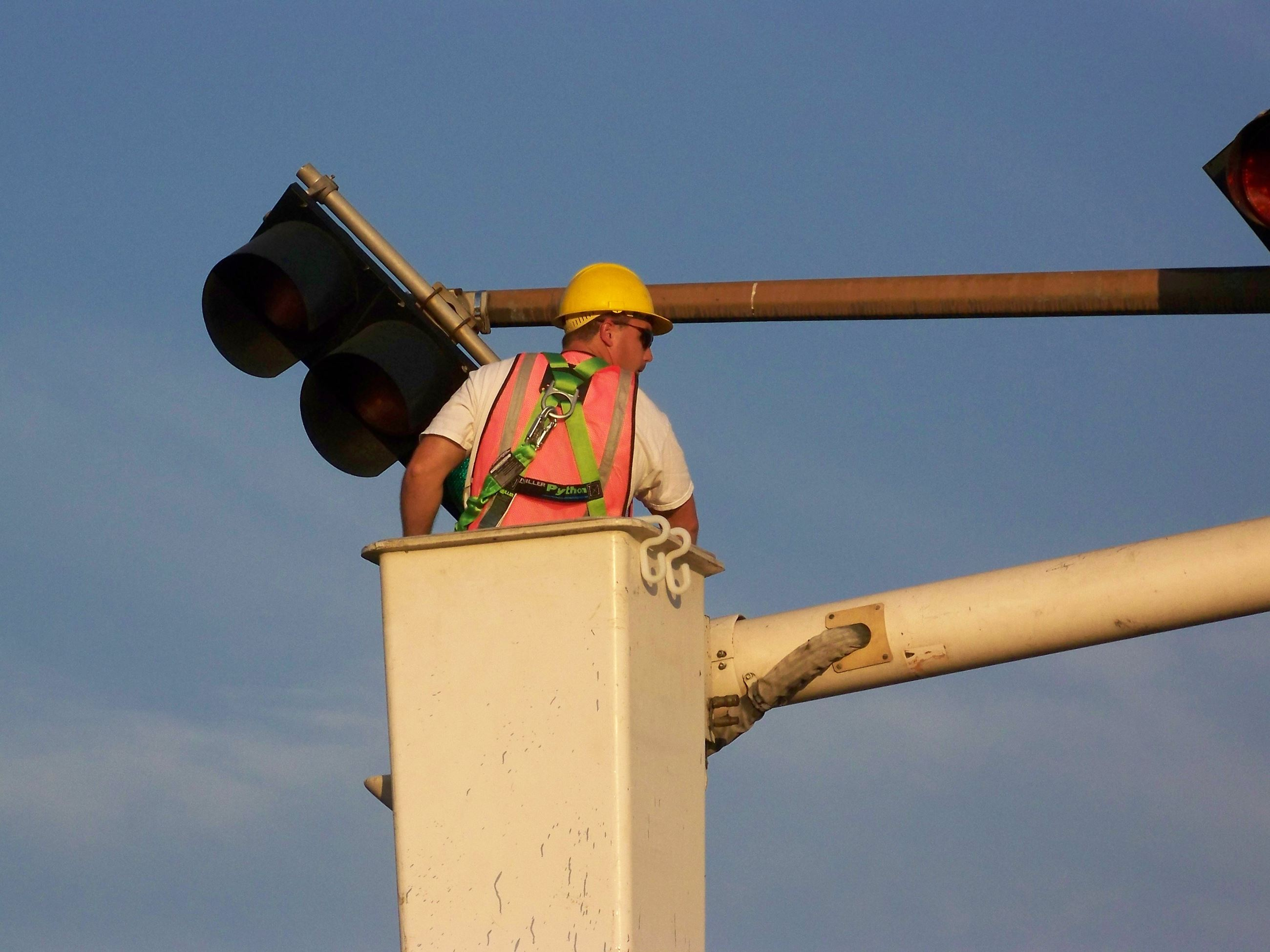 Utility Worker Working on Street Light